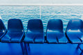 Blue seats on a ferry empty close up Royalty Free Stock Images