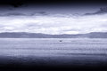 Blue sepia boat in Norway sea landscape background Royalty Free Stock Photo
