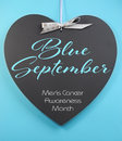 Blue september for mens health awareness month message greeting on heart shape blackboard aqua background Stock Image