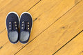 Blue shoes on wooden floor boots Stock Images