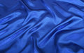 Blue silk shine textile for background Royalty Free Stock Images