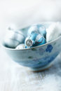 Blue and silver christmas balls in a bowl shallow dof Royalty Free Stock Images