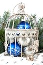 Blue and silver christmas balls in cage Royalty Free Stock Photo