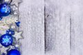 Blue and silver Christmas ornament side border on white wood Royalty Free Stock Photo
