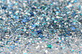 Blue and Silver Frozen Snow Winter Sparkling Stars Glitter background. Holiday, Christmas, New Year abstract texture
