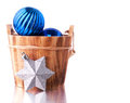 Blue and silver xmas decoration with wooden bucket place for text Stock Photography