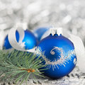Blue and silver xmas ornaments on bright background holiday Stock Image