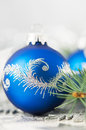 Blue and silver xmas ornaments on bright background holiday Royalty Free Stock Photo