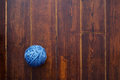 Blue skein over wooden background Royalty Free Stock Photo