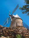 Blue sky behind a windmill traditional old stone wind mill on the french countryside Royalty Free Stock Images