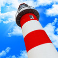 Blue sky and classic light house Royalty Free Stock Photos