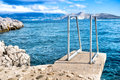 Blue sky and clear water sea horizon and rocks on island wallpaper background Stock Photography