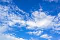 Blue sky closeup and fluffy clouds Stock Images