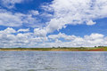 Blue sky with clouds over lake on summer lanscape Stock Photos