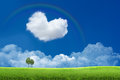 Blue sky with clouds and a rainbow Stock Photography