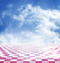 Blue sky with clouds reflected in the pink abstract fantasy checkerboard floor Royalty Free Stock Photo