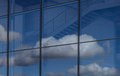 Blue sky and clouds reflection in office building window Royalty Free Stock Photo