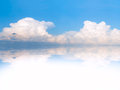 Blue sky clouds reflection water place your text Stock Image