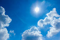Blue sky clouds sun bright Royalty Free Stock Photo