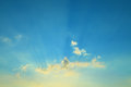 Blue sky with clouds and sun rays Royalty Free Stock Photo