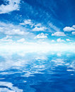 Blue sky clouds and water Royalty Free Stock Photo