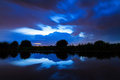 Blue sky a dark colored ominous at the river at night in the netherlands Stock Images