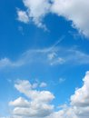 Blue sky with fleecy and cumulus clouds background Stock Photos