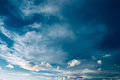 Blue Sky and Fluffy Clouds, Bright Cloudscape Background Royalty Free Stock Photo