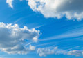 Blue sky and fluffy clouds white Stock Images