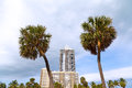 Blue sky and grey clouds over Miami Beach palms and buildings. Royalty Free Stock Photo
