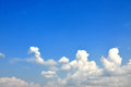 Blue sky with puffy clouds a lot of white Stock Photography