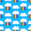 Blue sky with rainbows and clouds seamless pattern