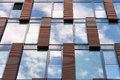 Blue sky reflected in mirror windows of modern office building Royalty Free Stock Photo