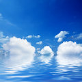 Blue sky a with reflection on water Royalty Free Stock Photography