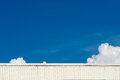 Blue sky and roof of warehouse with cloud the Stock Photography