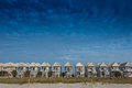 Blue Sky with a Row of Beach Homes Royalty Free Stock Photo