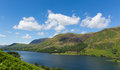Blue sky summer day buttermere lake district cumbria england uk with beautiful mountains english on a sunny surrounded by fells Stock Images