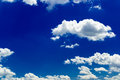 Blue sky sunny with puffy clouds Stock Image