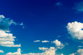 Blue sky sunny with puffy clouds Royalty Free Stock Photo