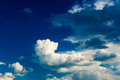 Blue sky sunny with puffy clouds Royalty Free Stock Images