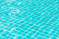 Blue sky swimming pool water texture reflection.