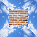 Blue sky in three dimensional measurement with white clouds and red brick wall Royalty Free Stock Image