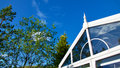 Blue sky, trees and clouds reflected in a conservatory. Royalty Free Stock Photo