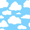 Blue sky with white clouds. Hand drawn seamless pattern. Vector illustration in cartoon style Royalty Free Stock Photo