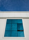 Blue sky white clouds window reflection with reflected in an open office set in a wall Stock Photography