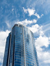 Blue Skyscraper Rising into Nice Blue Sky Royalty Free Stock Photo