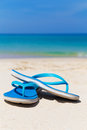 Blue slippers on the beach Royalty Free Stock Photo