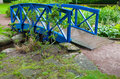 Blue small bridge over river stream creek in garden nature green and landscape Royalty Free Stock Photography