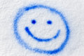 Blue smiley sprayed in the snow Royalty Free Stock Photo