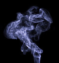 Blue smoke colored on a black background Stock Image